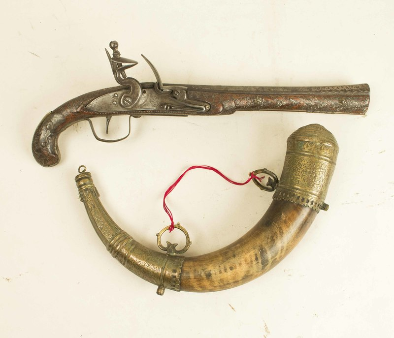 North African Flintlock Pistol with large powder horn.
