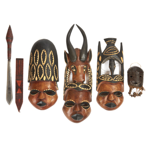 Three African Wood Masks, a Shell Mask and Taureg Sword and Scabbard