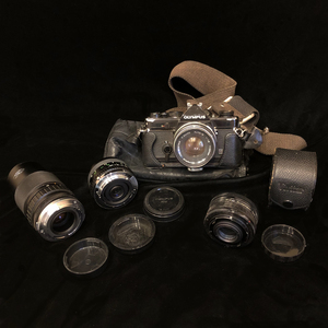 Olympus OM-1 Camera with Extra Lenses and Other Accessories