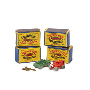 Two Matchbox Cars and Boxes