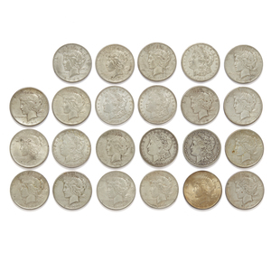 17 Peace Silver Dollars and 5 Morgan Silver Dollars