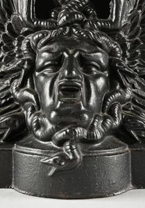A PAIR OF VICTORIAN CAST IRON MEDUSA HEAD DOOR STOPS, SCOTTISH, FALKIRK IRON CO, MARKED, CIRCA 1875,