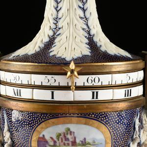 A NIDERVILLER FLORAL ENCRUSTED PARCEL-GILT BLUE GROUND PORCELAIN VASE CLOCK À CERCLES TOURNANTE, 19TH CENTURY,